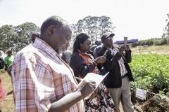 keen-farmer-taking-notes-